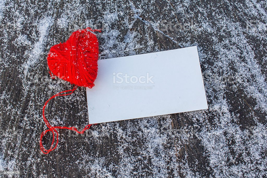 Red heart and empty card on a wooden background stock photo