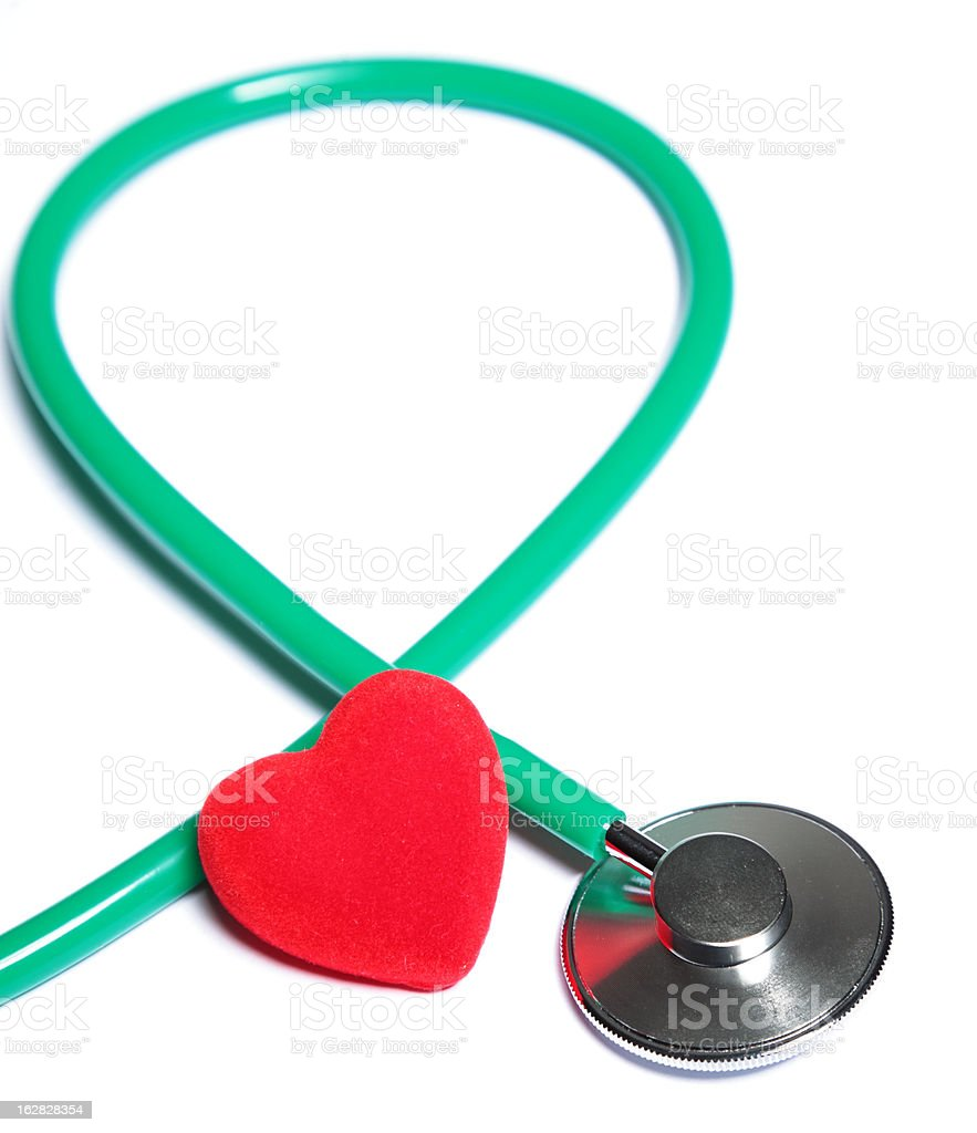 Red heart and green stethoscope isolated royalty-free stock photo