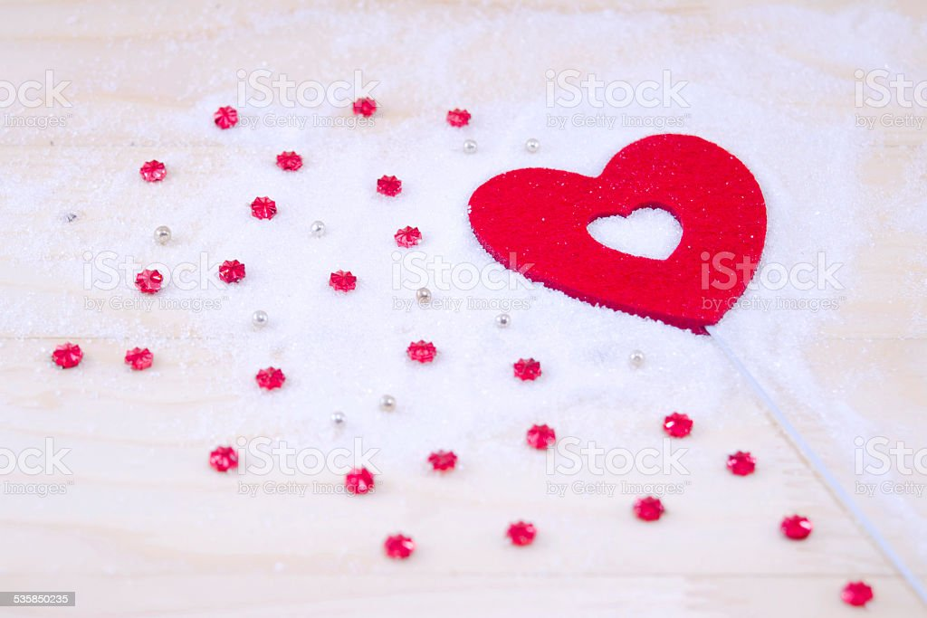 Red heart and red stars on white powder royalty-free stock photo