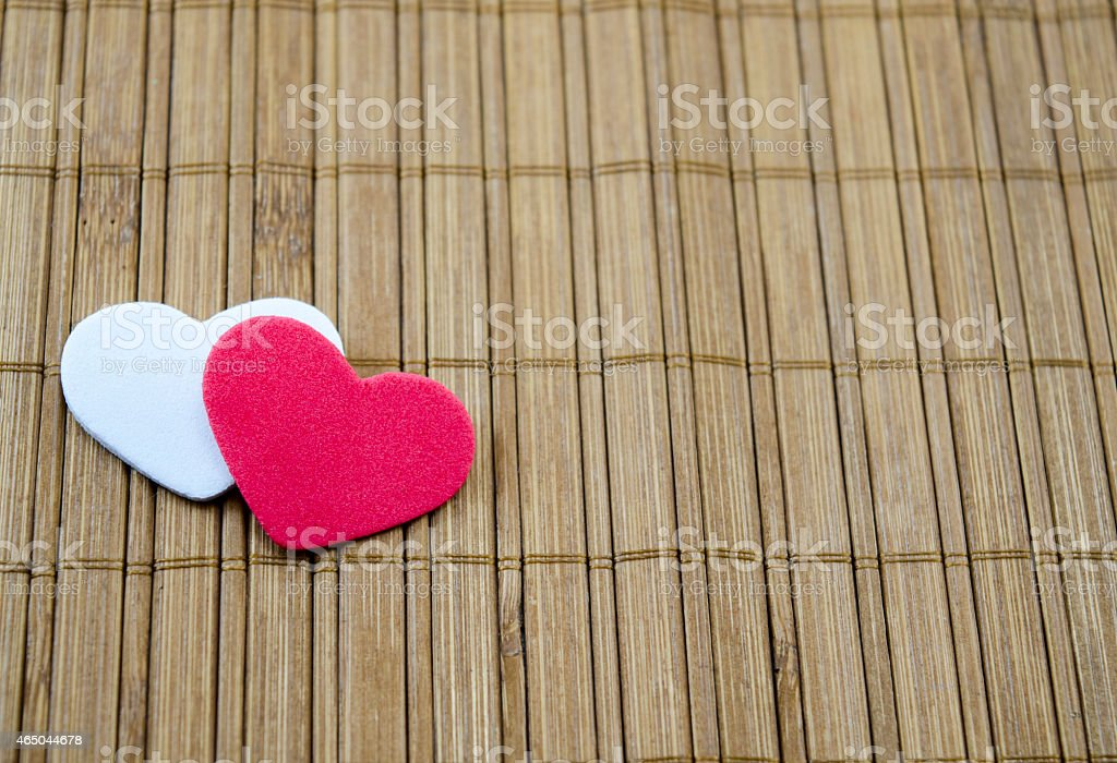 Red heart and white heart on a Japanese table royalty-free stock photo