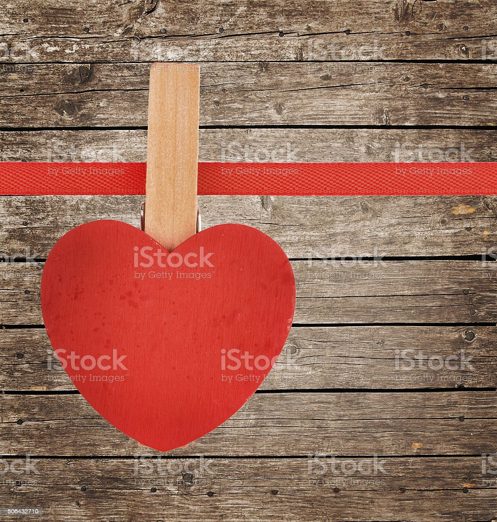 Red heart at ribbon on vintage wooden surface royalty-free stock photo