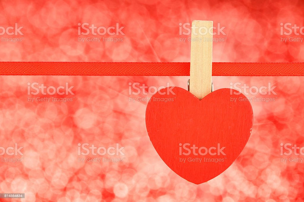 Red heart at ribbon over red glitter blur royalty-free stock photo