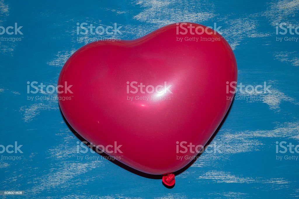 Red Heart Ballon on a blue background stock photo
