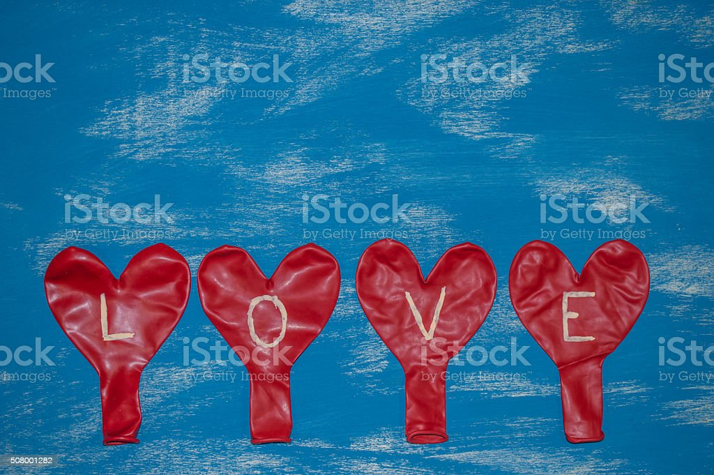 Red Heart Ballons on a blue background stock photo
