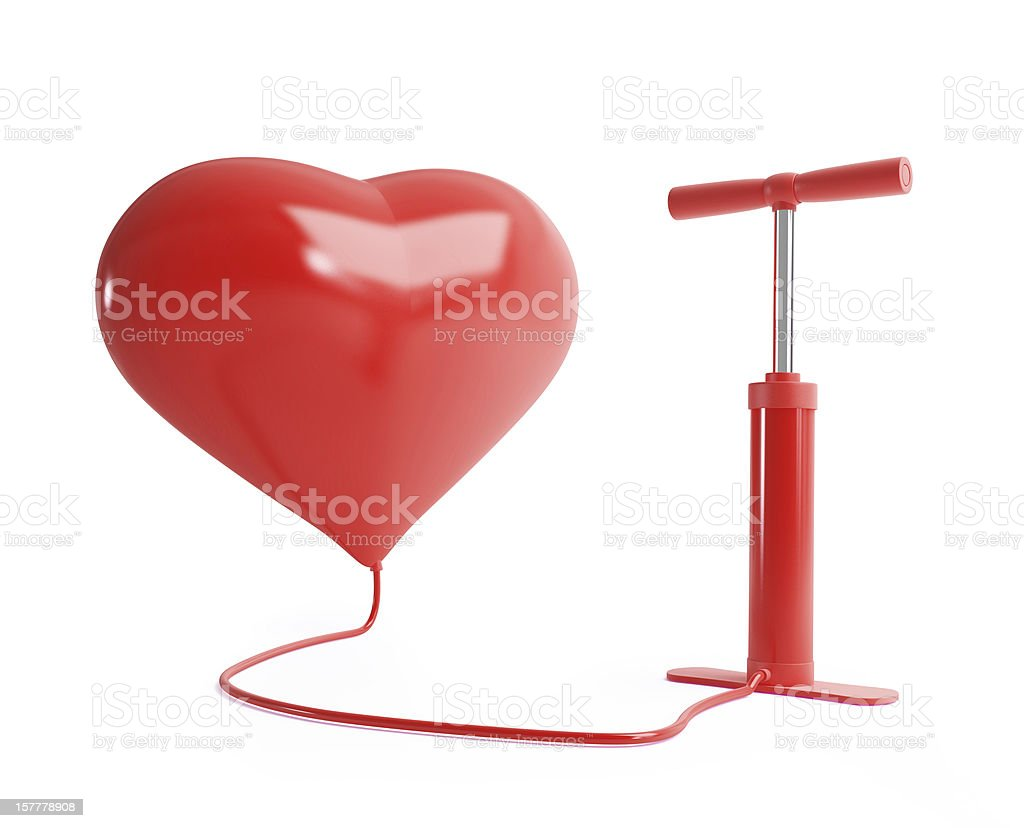 Red heart balloon getting inflated by a red pump stock photo