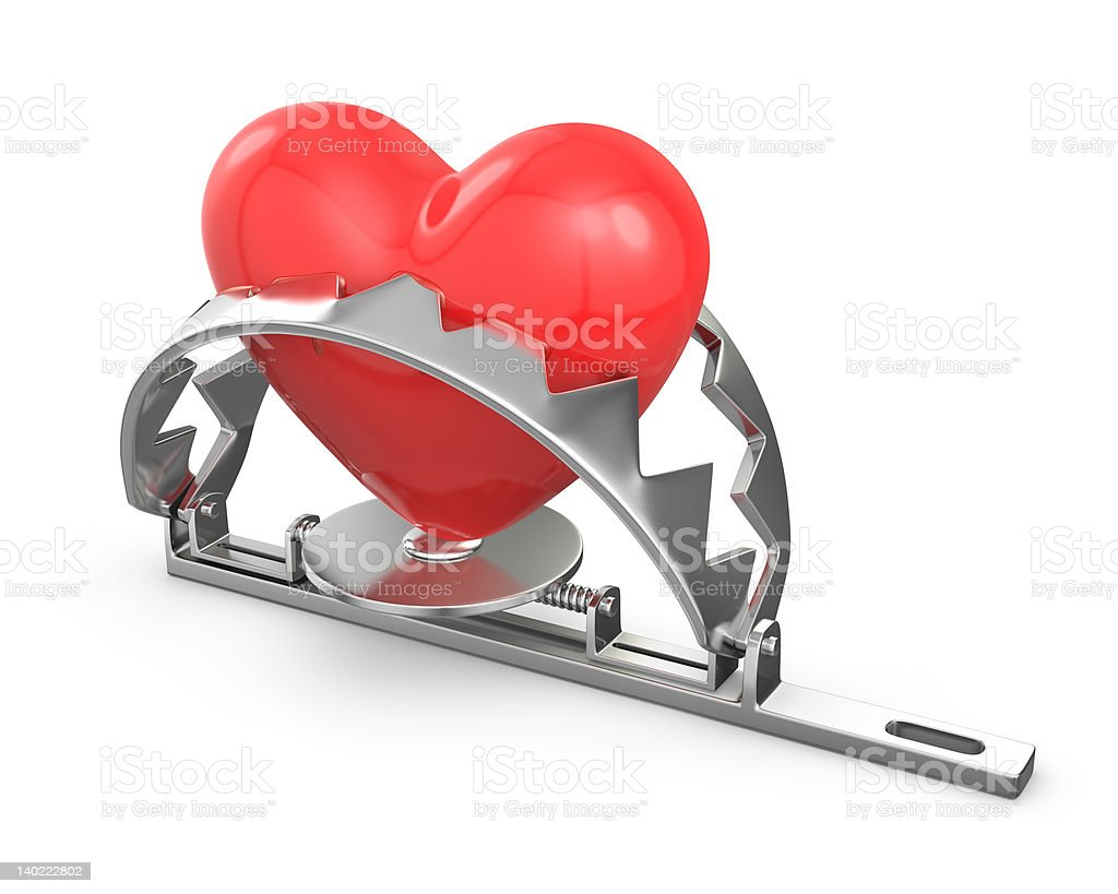 Red heart caught in a trap stock photo