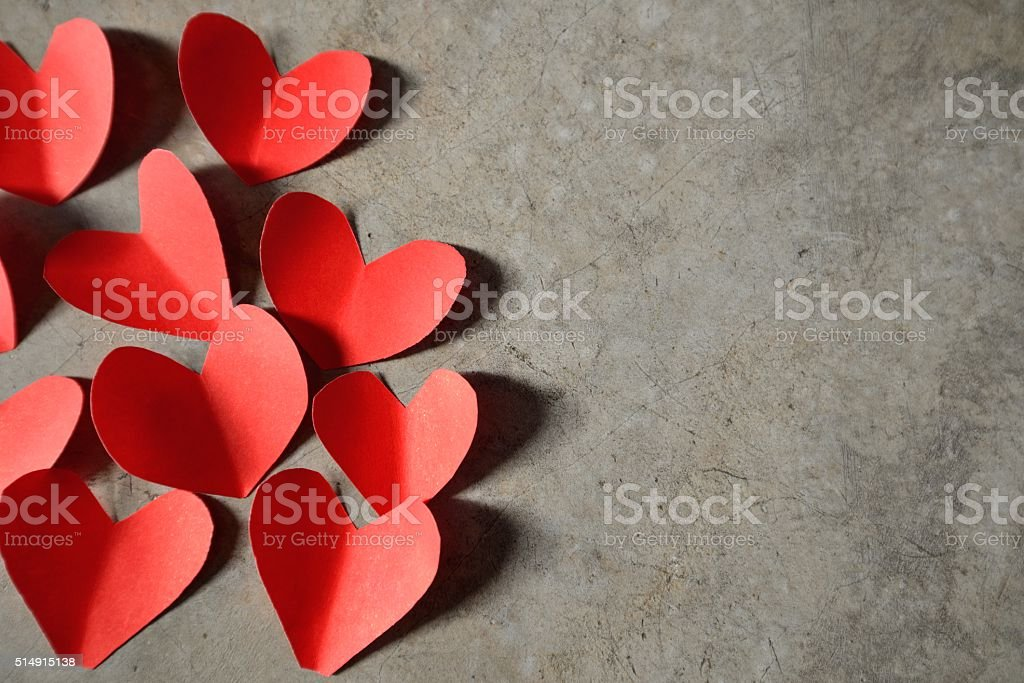 red heart cement background stock photo