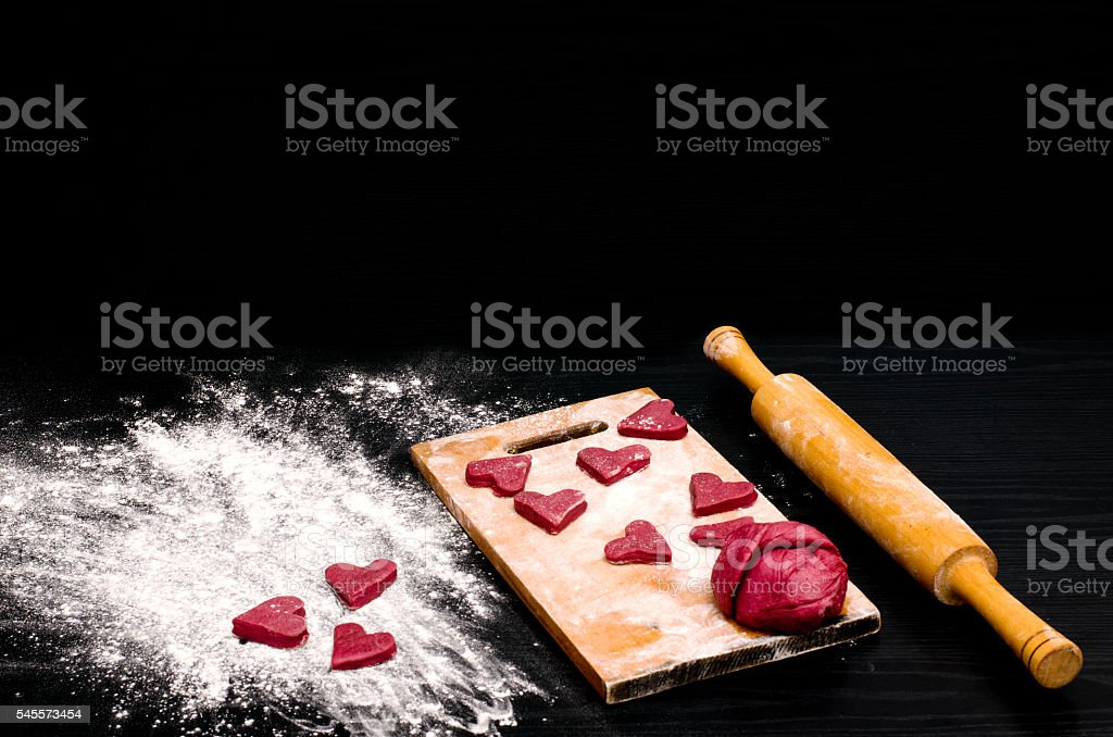 Red heart cookies on black table, baking for Valentine's Day stock photo