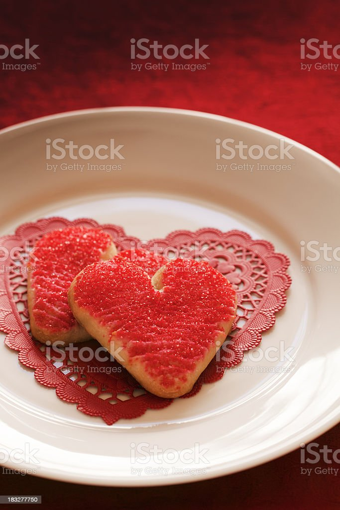 Red Heart Dessert Cookies on White Plate for Valentine's Day royalty-free stock photo
