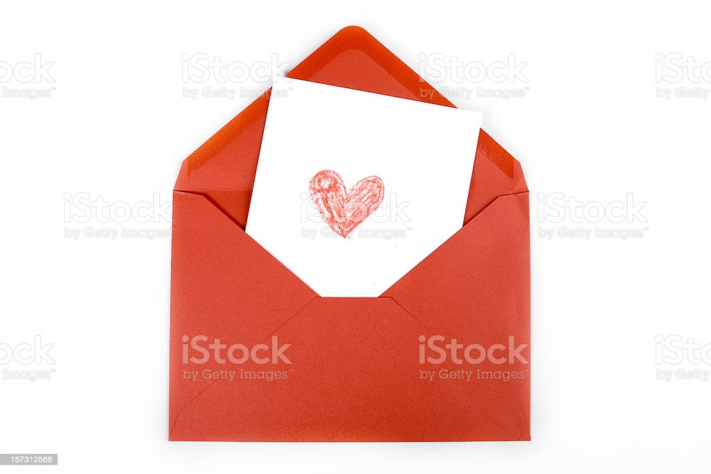 Red heart drawn on white card within red envelope stock photo