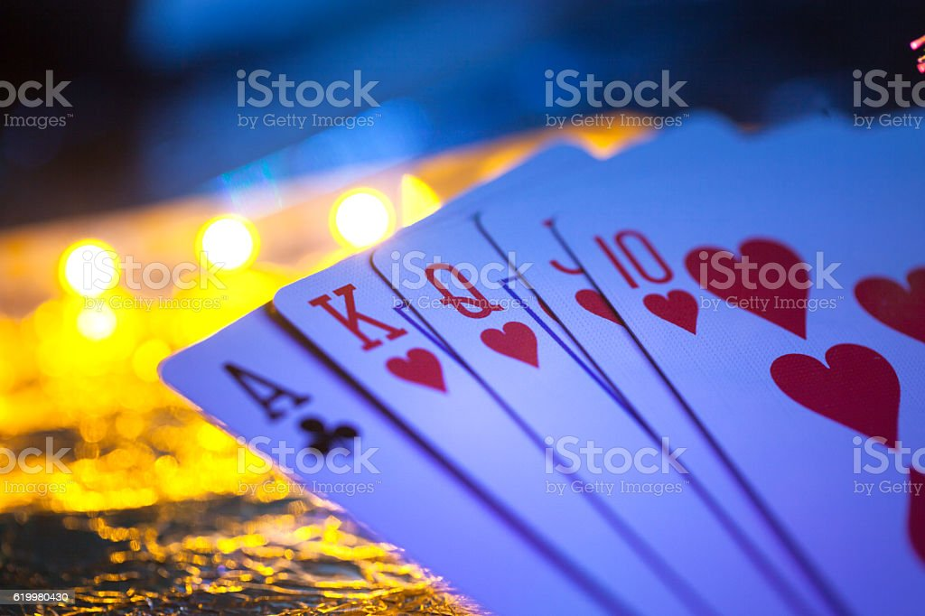 red heart flush with one bad club in the gambling stock photo