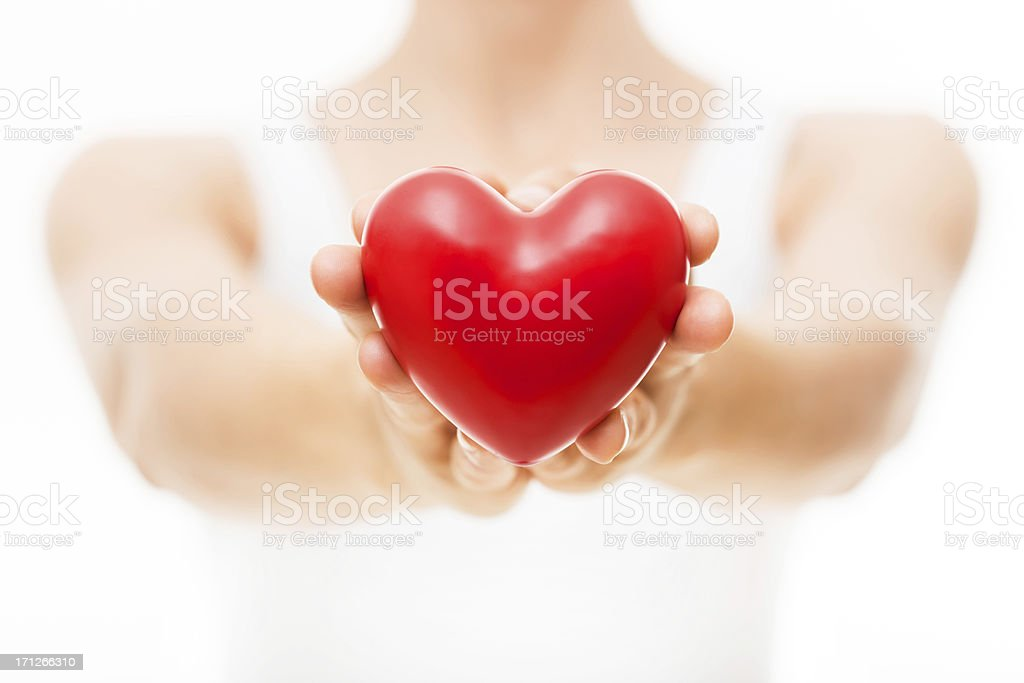 Red heart given by female hands royalty-free stock photo