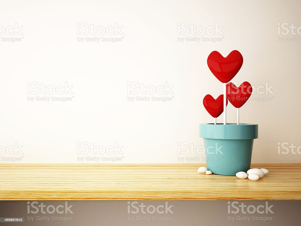 red heart in flower pot stock photo