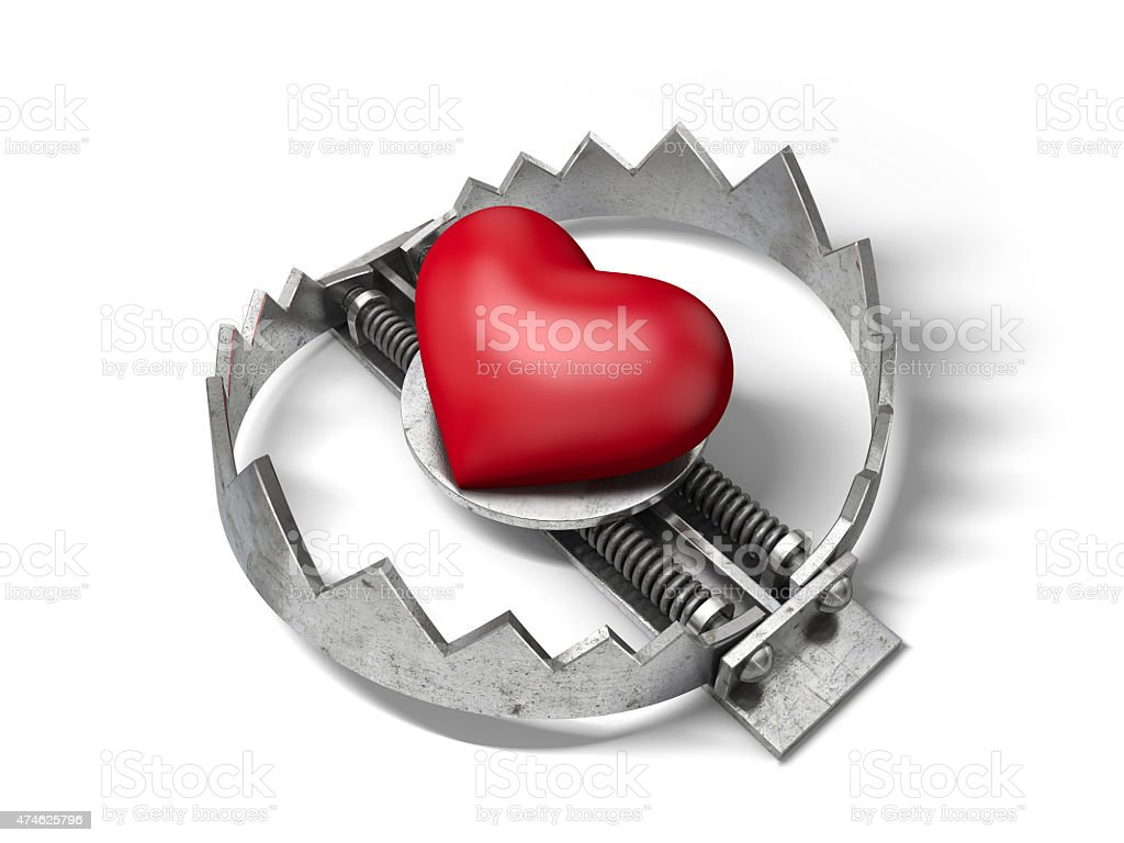 Red heart in the bear metal trap stock photo