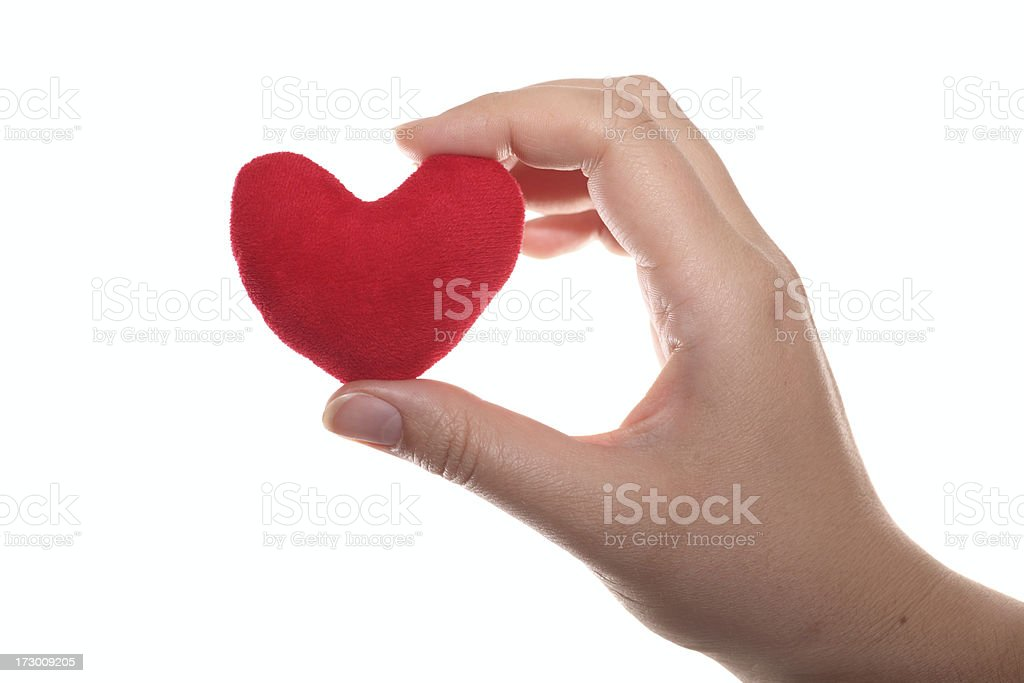 Red heart in the hand stock photo
