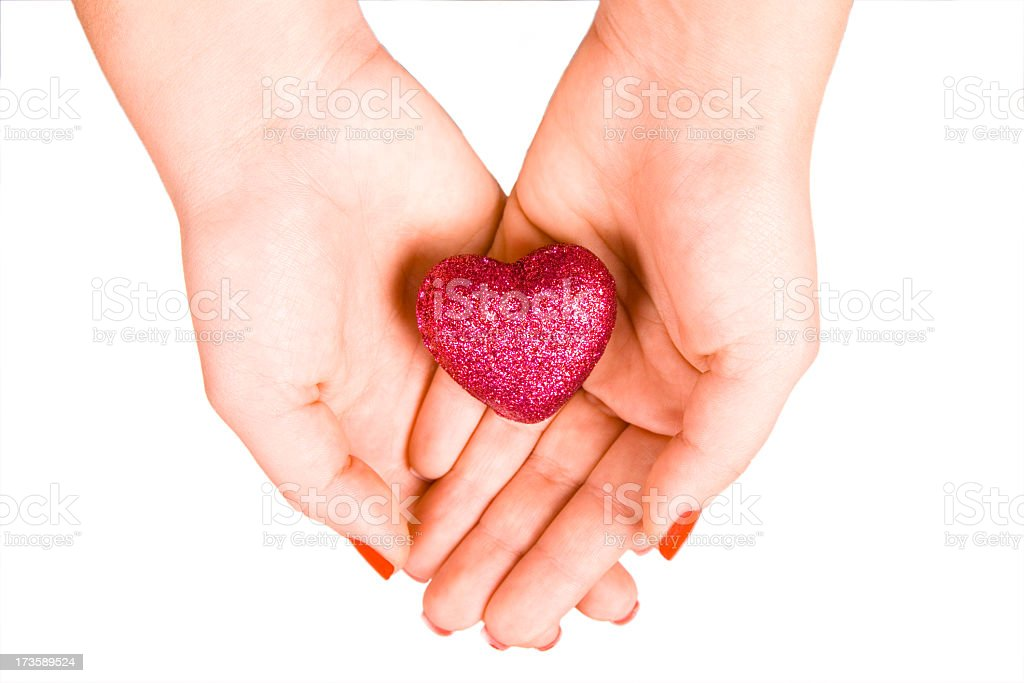 Red heart in the hands stock photo