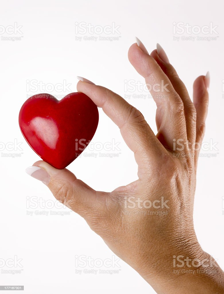 Red heart in woman hand on white royalty-free stock photo