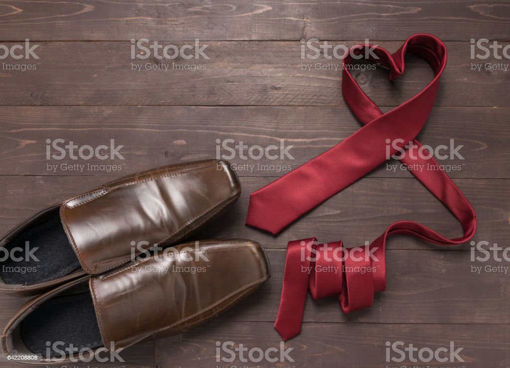 Red heart necktie and shoes are on wooden background stock photo