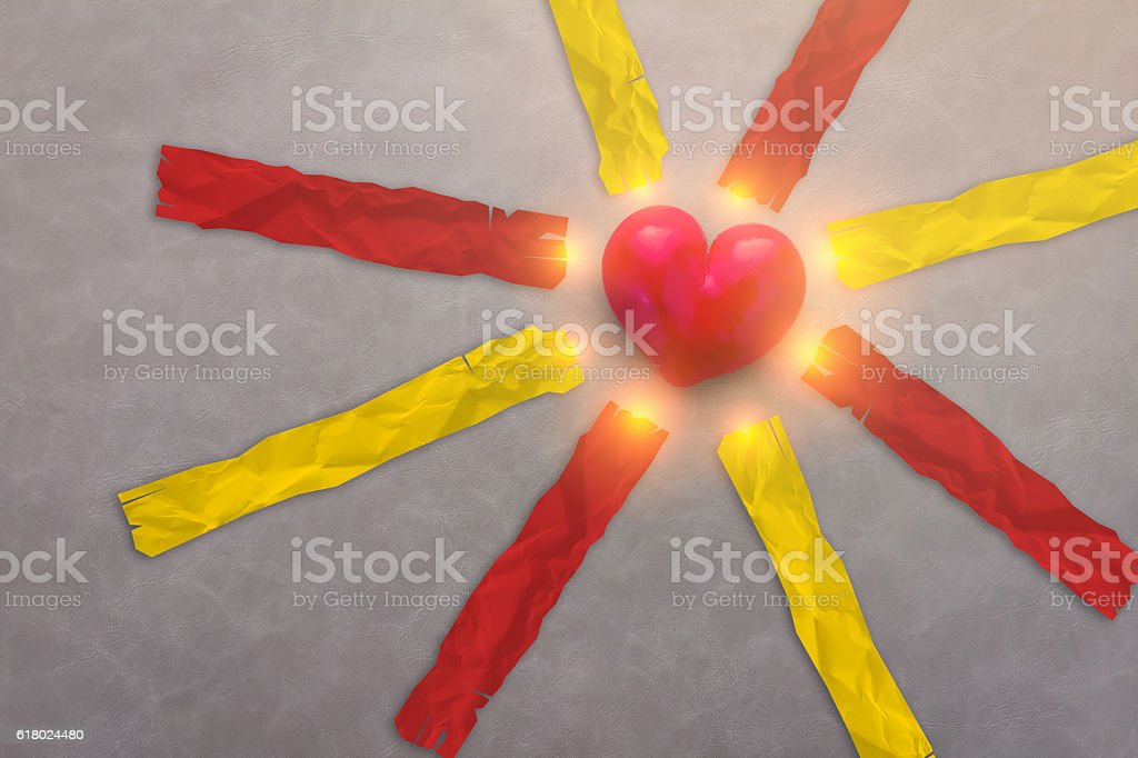 red heart object with red and yellow paper tags stock photo