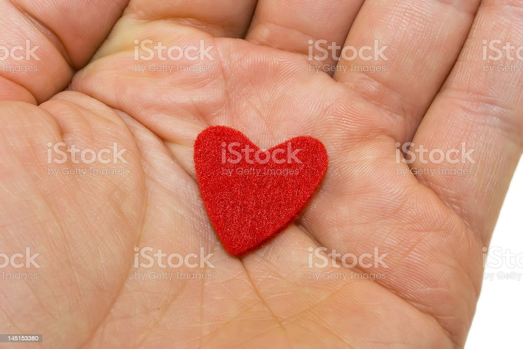 Red heart on hand stock photo
