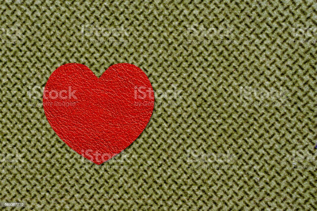 red heart on olive fabric, 23 february army day concept stock photo