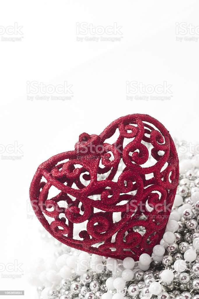 Red heart on siler pearls, white background royalty-free stock photo