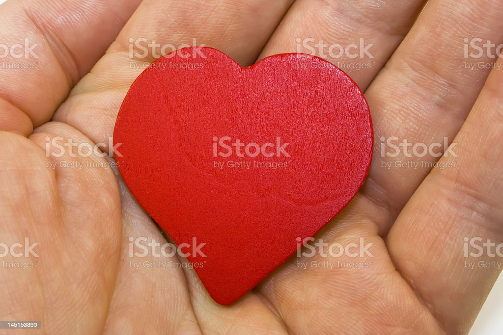 Red heart on the hand stock photo
