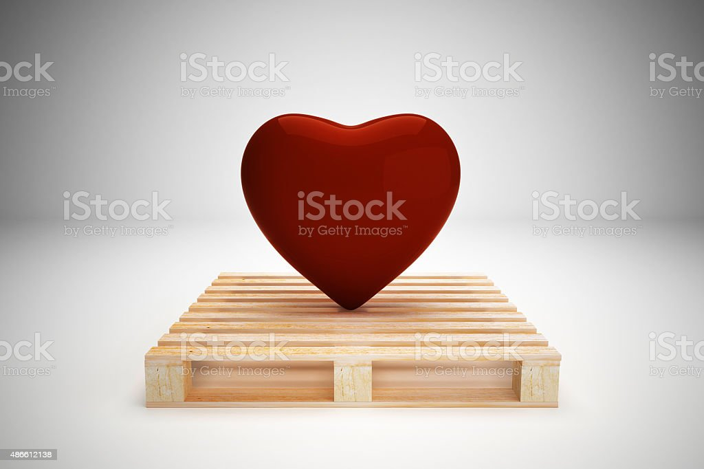 Red heart on wood pallet, transportation concept stock photo