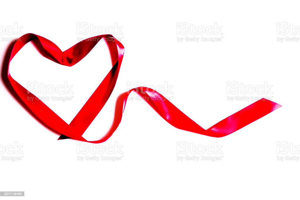 Red heart, satin ribbon.  White background.  Christmas, Valentine's Day. stock photo