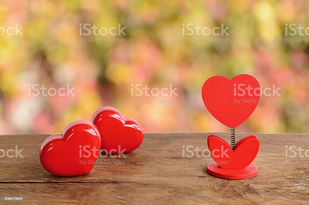 red heart shape and blank note on old wooden background, stock photo