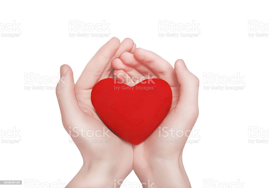 Red heart shape in hands. Valentine's day, charity and love stock photo