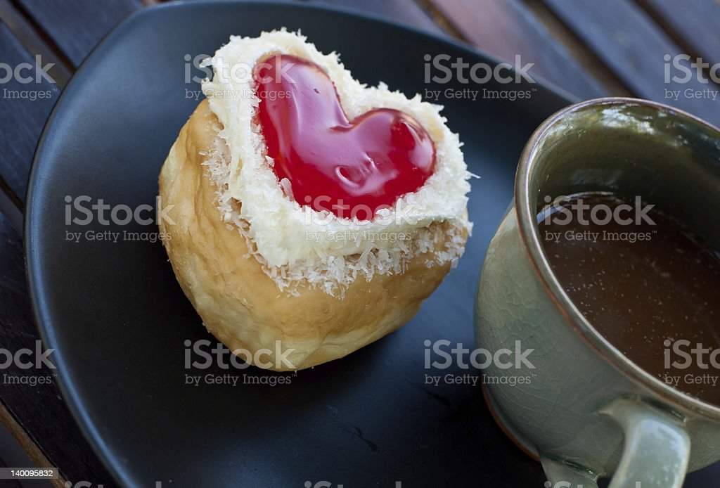 red heart  shape of  donut with coffee . royalty-free stock photo