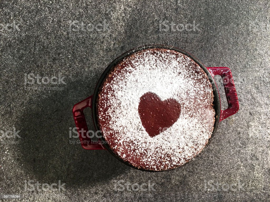 Red heart shape on black slate background and souffle stock photo