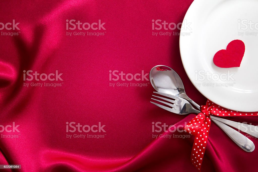 red heart shape with White plate with fork and spoon stock photo