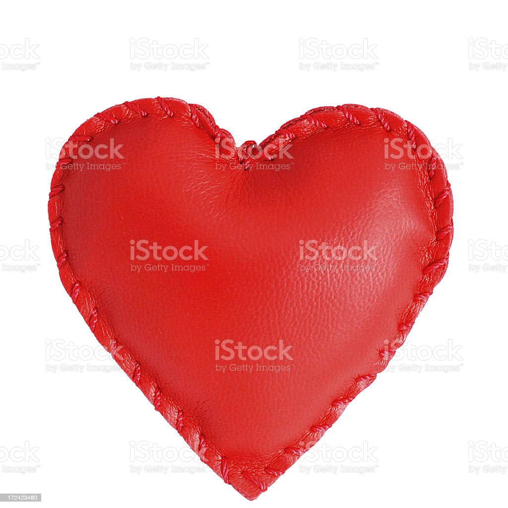 Red heart shaped leather pillow on white background royalty-free stock photo