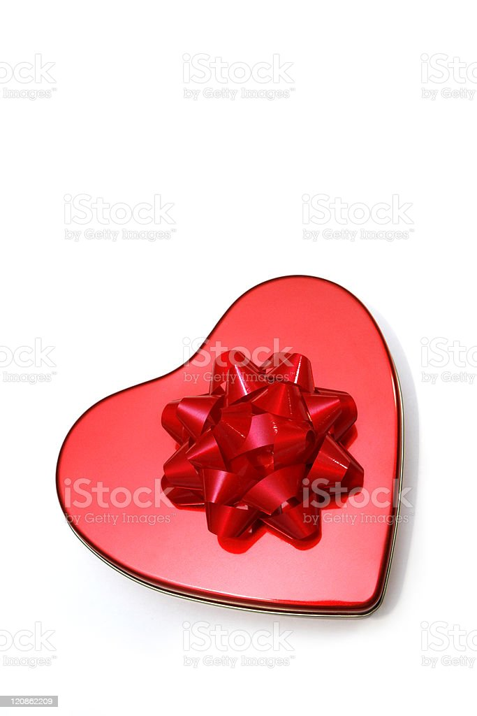 Red heart shaped metallic box with ribbon on white background royalty-free stock photo