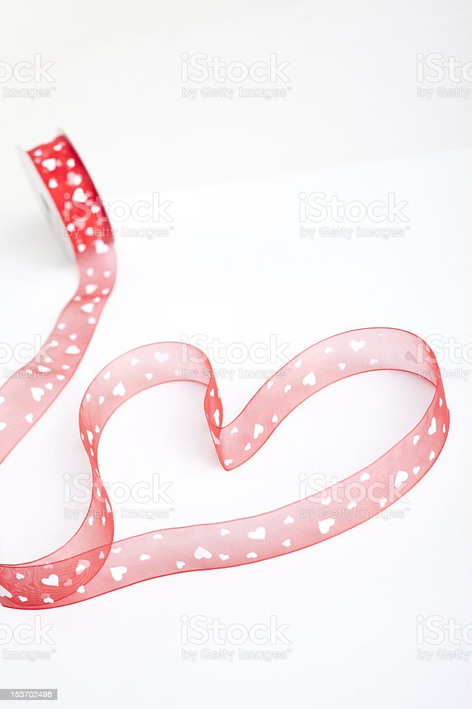 Red Heart Shaped Ribbon with white hearts royalty-free stock photo