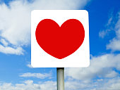 Red heart sign on blue skies and clouds
