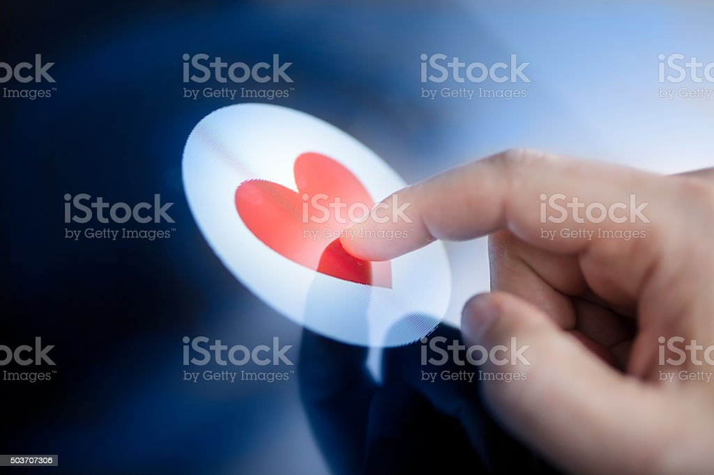 Red heart touch display stock photo
