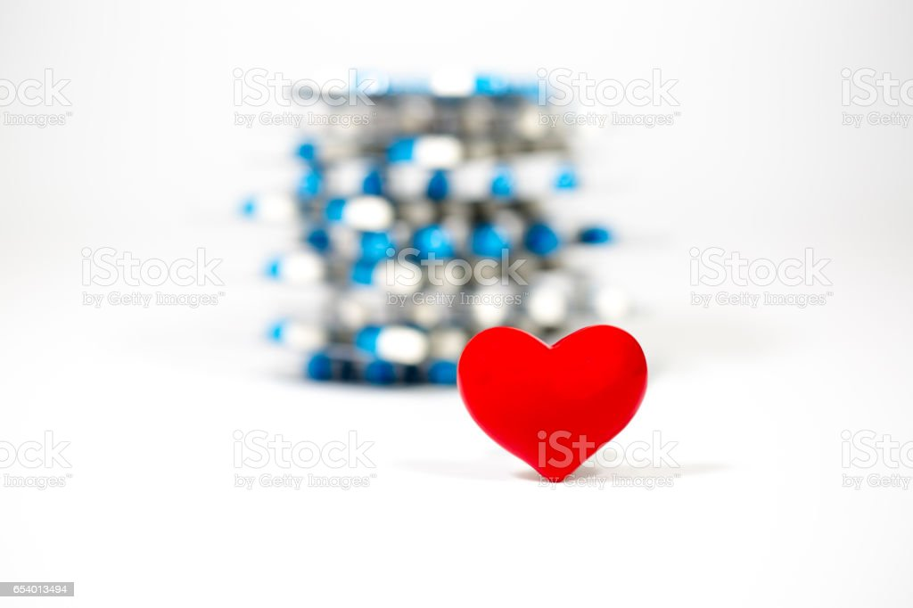red heart with medical drug background stock photo