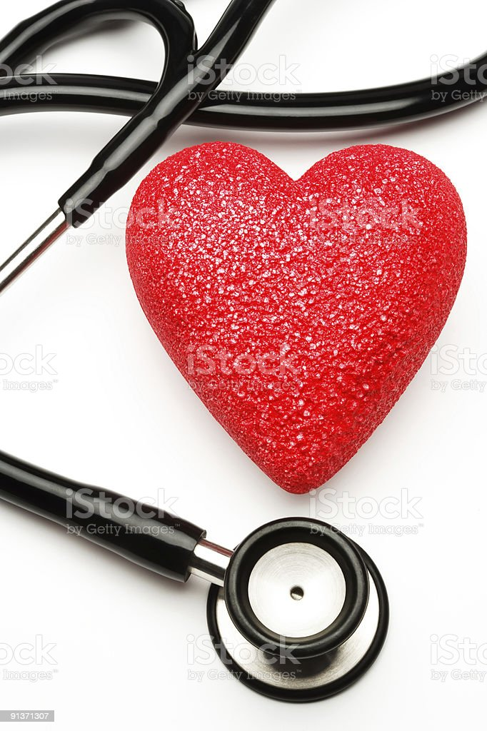 Red heart with stethoscope implying health stock photo