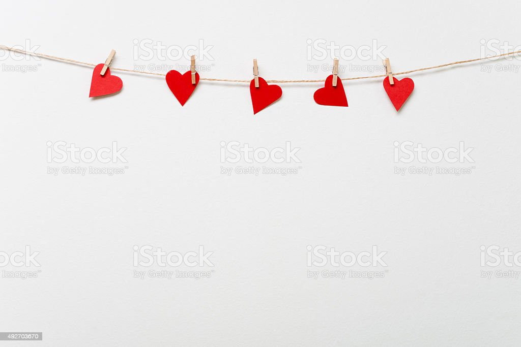 Red hearts hanging on clothesline stock photo