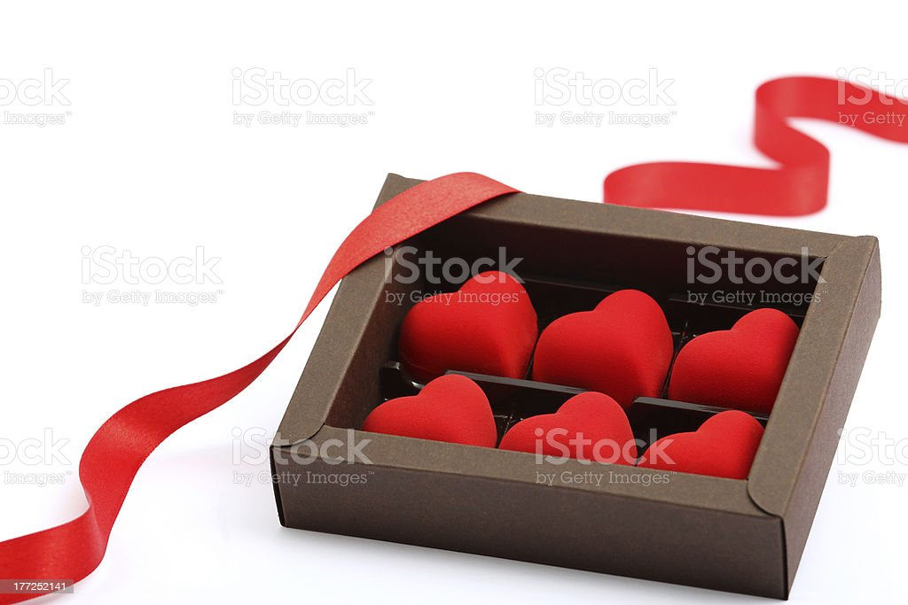red hearts in brown box on white background royalty-free stock photo