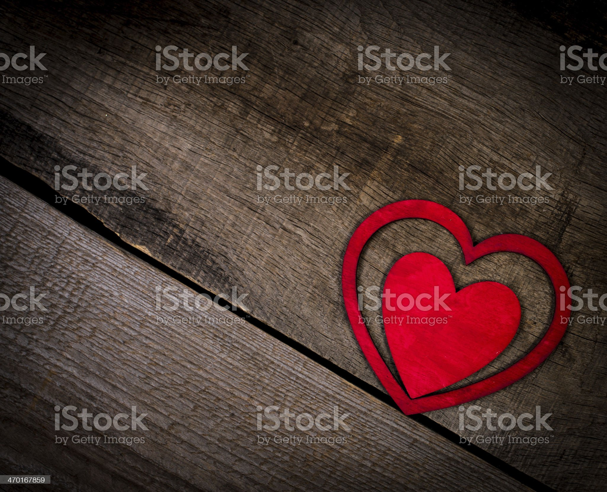 Red hearts on old wood with copy space. royalty-free stock photo