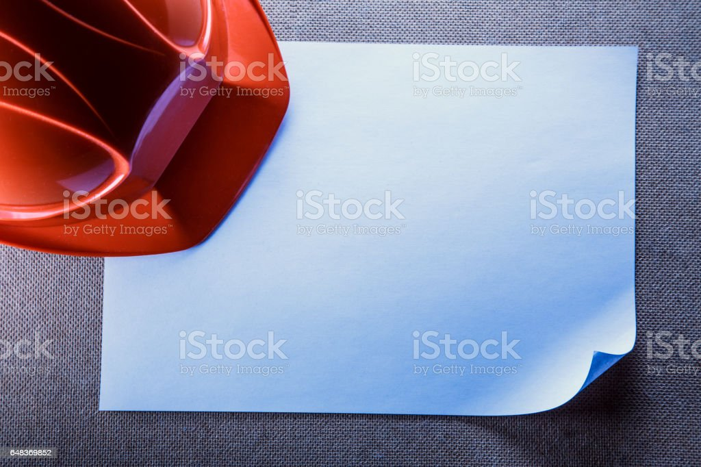 Red helmet and blank paper stock photo