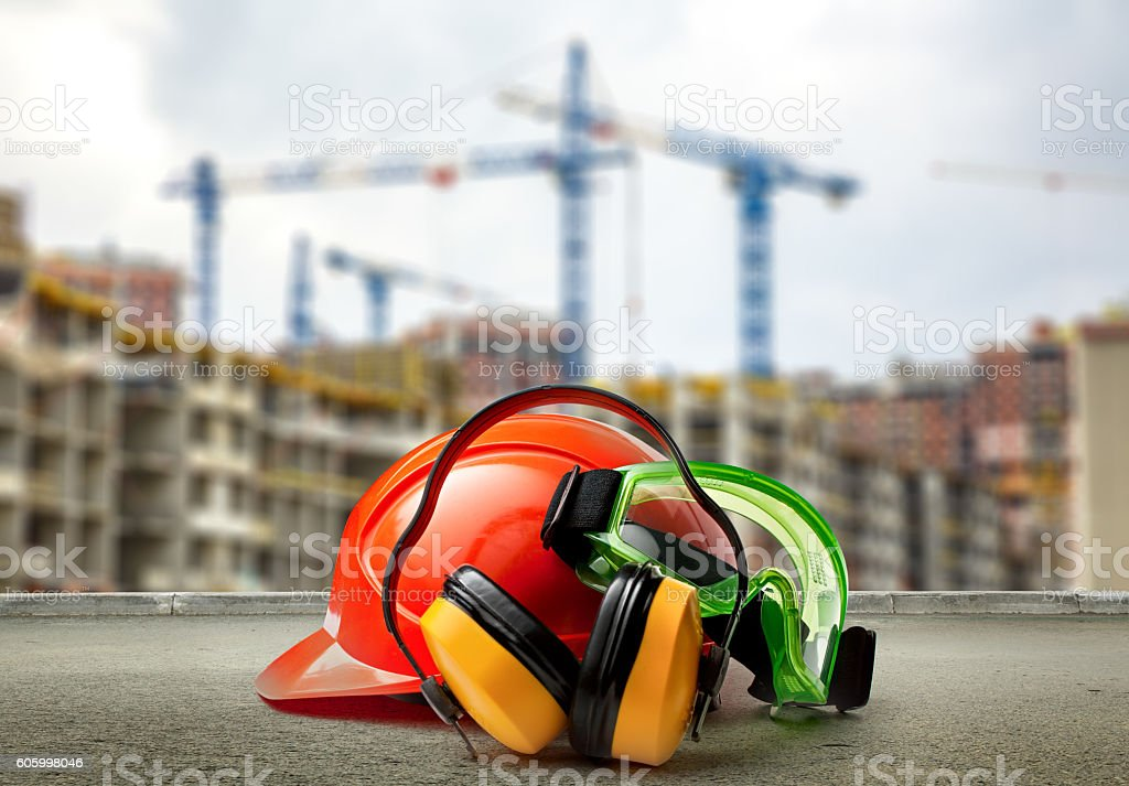 Red helmet and earphones on buildings background stock photo