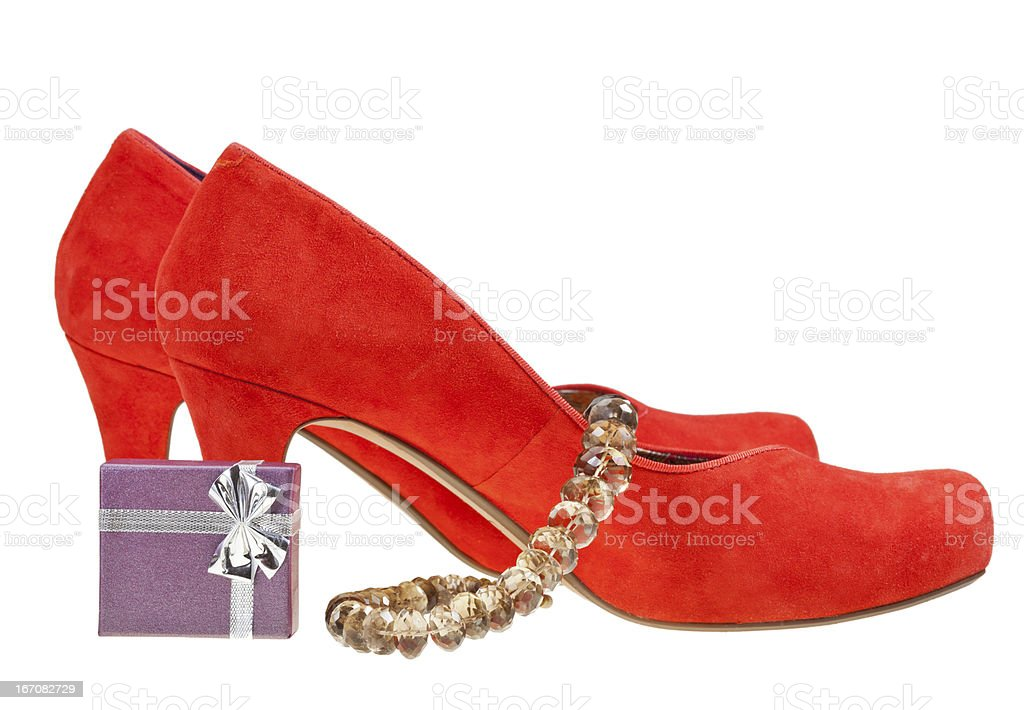 red high heel pumps with small gift box and necklace royalty-free stock photo