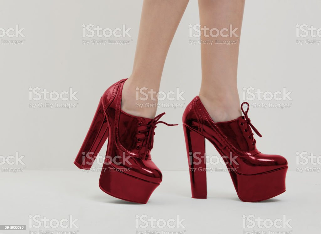 red high heels shoes on women's legs stock photo
