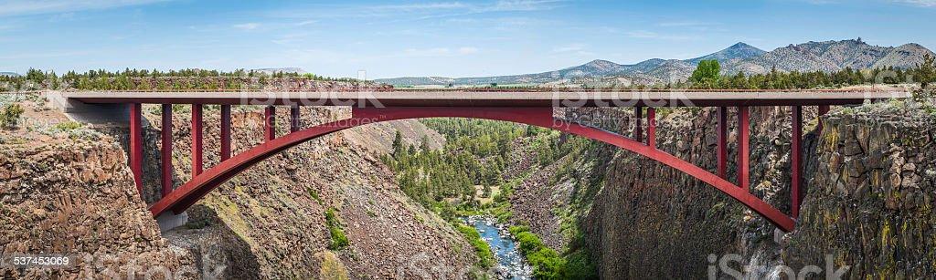 Red highway bridge across ravine in high desert panorama USA stock photo