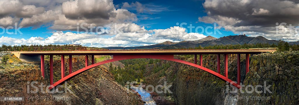 Red  highway  bridge across ravine in high desert stock photo